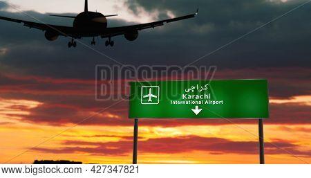 Plane Landing In Karachi Pakistan Airport With Signboard
