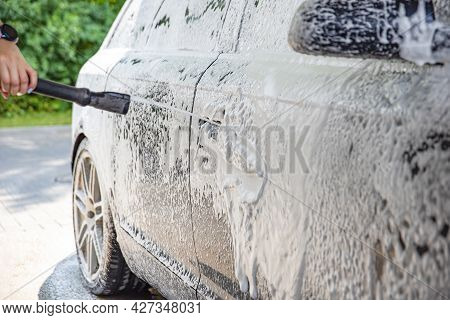 Car Wash. The Process Of Washing A Car With Active Foam Under Pressure. Self-service Manual Car Wash