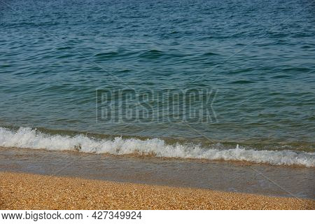 View Of The White Beatiful Sand. Empty Beach Near Sea On Sunny Day. Ocean Landscape.
