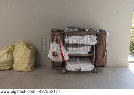 View Of Hotel Maid Table With Fresh Clothes. Hotel Business Concept. Greece.