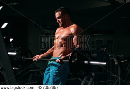 Bar Execises. Bodybuilder In Gym. Training And Workouts. Sporty Sportsman With Naked Torso. Athletic