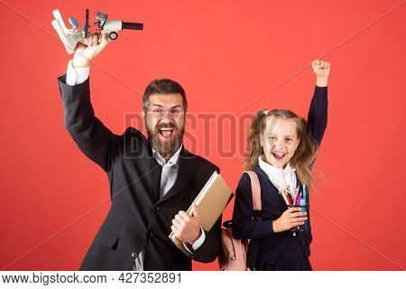 Amazed Teacher With Excited Happy Pupil School Girl. First Day At School. Father And Little Child Sc