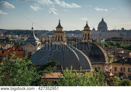 Overview Of Trees, Cathedrals Domes And Roofs Of Buildings In Rome. The Incredible City Of The Ancie