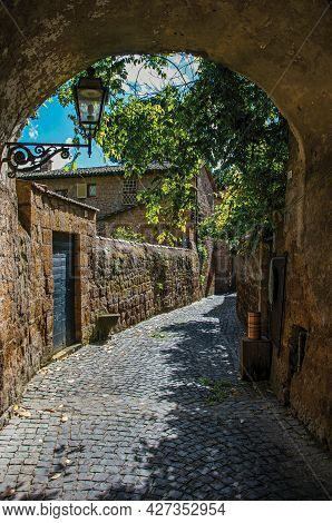 Narrow Alley With Sidewalk And Stone Walls. In The Town Of Orvieto, A Pleasant And Well Preserved Me