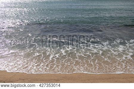 Beach Background. Calm Beautiful Ocean Wave On Sandy Beach. Sea View From Tropical Sea Beach.