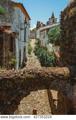 Stone Arch In Wall Over Cobblestone Pathway Going To The Historical City Center At Castelo De Vide.
