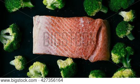 Fresh Organic Atlantic Salmon Fillet On Baking Tray With Green Broccoli Florets As Healthy Food Nutr
