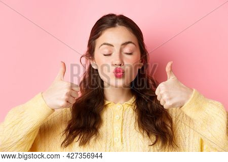 Beauty And Fashion. Close Up Portrait Of Lovely And Coy Girl Pucker Lips With Eyes Closed, Showing T