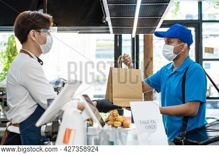 Asian Food Delivery Man Receive Beverage Order From Restaurant Worker. Waiter Wearing Protective Mas