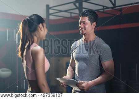 Active Sport Athlete People With Six Pack Abs Friend Talking In Gym. Caucasian Man Fitness Trainer I