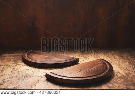Pizza cutting board for homemade bread cooking or baking on table. Empty pizza board at wooden tabletop background. Bakery concept in kitchen
