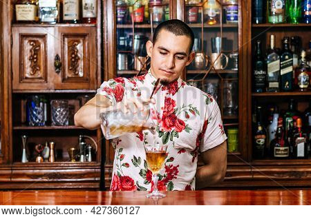 Pro Barman Prepare Coctail Drink And Representing Nightlife And Party Event Concept.