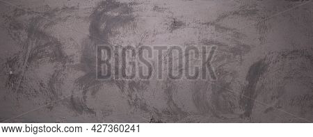 Abstract grey concrete wall background texture. Gray plaster wall surface with copy space