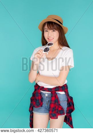 Beautiful Portrait Young Asian Woman Wear Hat And Holding Sunglasses Smiling Confident Enjoy Journey