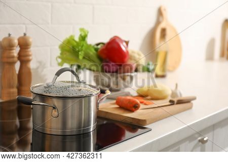 Pot With Delicious Bouillon On Cooktop In Kitchen. Homemade Recipe