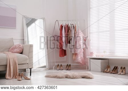 Modern Dressing Room Interior With Clothing Rack And Mirror