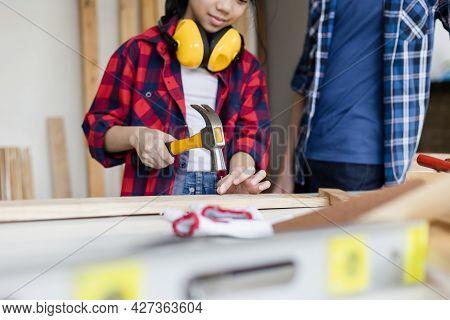 Children Team Learning Woodworking In The Craftsman Workshop, Kids Building A Workshop In A Carpentr