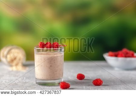Oatmeal Milkshake With Bananas And Raspberries. Healthy Diet Food