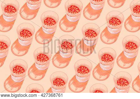 Creative Pattern Made With Glass With Lemonade Or Water And Sliced Citrus On Pastel Background. Summ