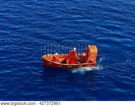 Offshore Life boat or survival craft at muster station of oil and gas drilling rig