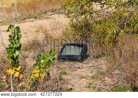 Old Discarded Tv Set In A Deserted Place