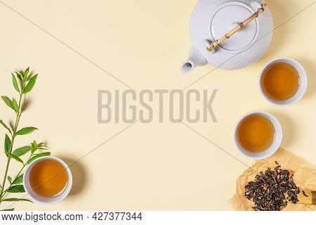 Asian Tea Ceremony With Teapot And Tea Cups Top View. Aroma Herbal Tea Drink.
