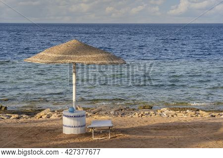 Luxury Sand Beach With Beach Chairs And Straw Umbrellas In Tropical Resort In Red Sea Coast In Sharm