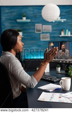 African American Student Waving Remote School Collegue During Online Videocall Meeting Teleconferenc