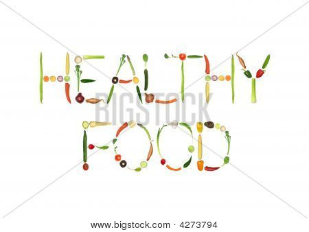 Vegetable selection spelling the words healthy food over white background. poster