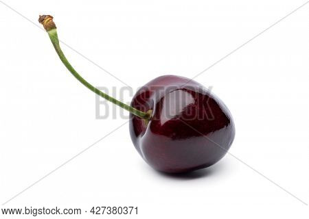 Single red ripe juicy cherry isolated on white background
