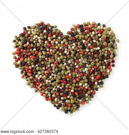 Mixture of peppercorns in heart shape isolated on white background
