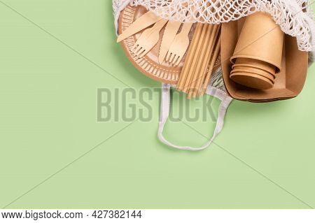 Kraft Paper Food Cups, Plates And Containers With Wooden Cutlery In Cotton Bag On Green Background W