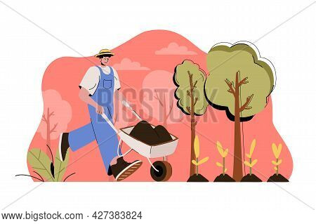 Agrarian Concept. Farmer With Wheelbarrow Works On Farm, Planting Seedlings Situation. Gardening, Pl
