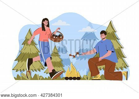 Caravan Camping Concept. Couple Resting In Forest, Picking Mushrooms And Frying On Campfire Situatio