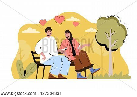 Caring For Each Other Concept. Happy Loving Couple Talks Sitting On Bench In Park Situation. Relatio