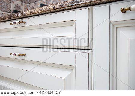 Kitchen Doors And Drawers Of White Vintage Kitchen In Country Style Design With Granite Countertop C