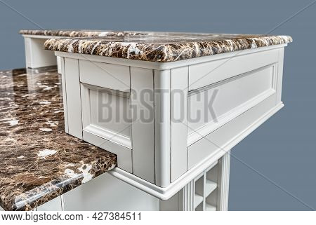 Fragment Of Kitchen Island With Doors And Granite Countertops In Country Style Design Isolated On Gr