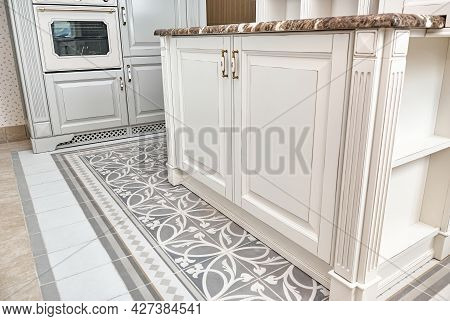 Kitchen Island With Doors And Granite Countertop In Country Style Design And Patterned Tiles On The