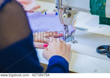 Professional Tailor, Fashion Designer Sitting And Working At Sewing Studio, Atelier. Close Up View O