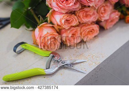 Close Up View - Floral Cutter And Colorful Flowers Bouquet - Roses On Table At Studio, Flower Shop.