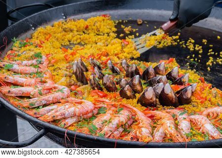 Cooked Paella With Shrimp, Mussel, Rice, Saffron In Huge Paella Pan At Summer Outdoor Food Market: C