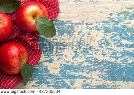 Gala Red Apple. Fresh Fruits And Green Leaves On Wooden Table. Copy Space. Top View