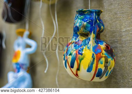 Unusual Glaze Ceramic Hanging Decor - Colorful Jug On Earthenware Exhibition - Close Up View. Handma