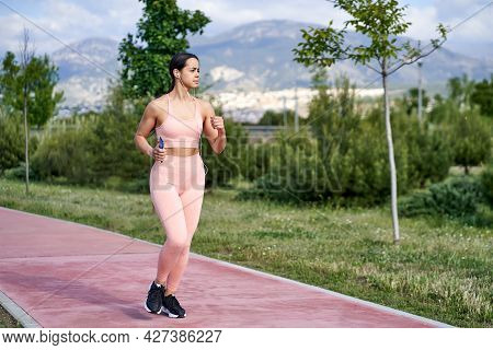 Young Woman With Fit Body Running. Female Model