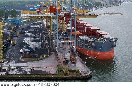 Swinoujscie, West Pomeranian - Poland - 2020: Bulk Carrier At The Transhipment Terminal In A Seaport
