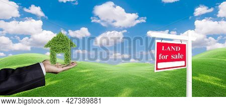 Panorama House Symbol And Land For Sale Signboard On The Meadow Under Clear Sky In Real Estate Sale