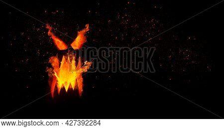 Pumpkin With Burning Mouths And Eyes On Blank Black Background. Jack-o-lantern Decoration.