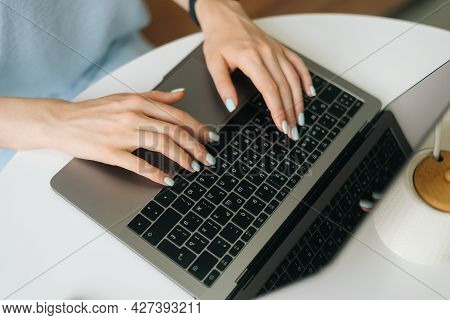 Close-up Top View Of Unrecognizable Young Woman Wearing Smart Watch Typing On Laptop Keyboard Sittin