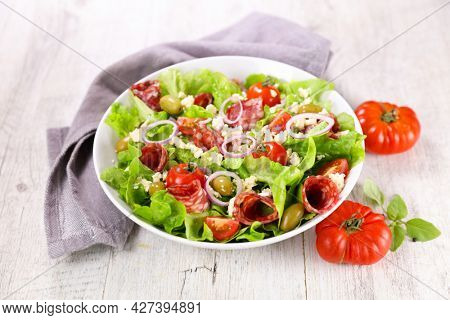 vegetable salad with salami and tomato