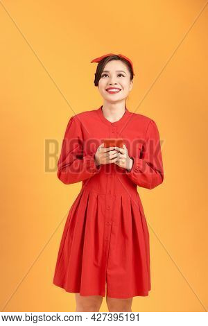 Image Of Gorgeous Woman In Casual Being Surprised Or Excited To Receive Pleasant Text Message On Her